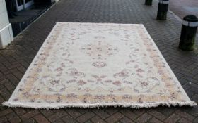 A Genuine Excellent Quality Iranian Cream Ground Carpet/Rug. Decorated throughout in a bespoke
