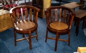 A Pair of Modern Tub Chairs with Bergere seats, raised on four square tapering supports.