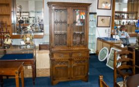 'Old Charm' Carved Oak Glazed Top Cabinet in the Jacobean style, with a leaded glass top,