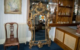 """A Large Gilt Rococo Style Wall Mirror, of typical form. Measures 71"""" x 38""""."""