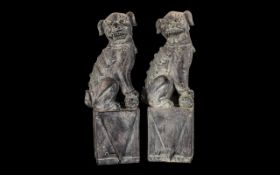 Pair of Chinese Foo Dogs, large decorative pieces. Dogs measure 40 cm high.