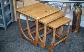G Plan: Nest of Designer Interlocking Teak Coffee Tables with signature design details,