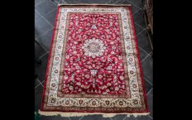A Genuine Excellent Quality Cashmere Deep Red Ground Carpet/Rug. Decorated throughout with Sharbas