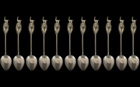 Set of Eleven South American Silver Spoons with an Alpaca finial; unmarked,
