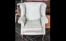 Modern Laura Ashley Style Wing Armchair on small turned wooden legs with brass castor, covered in