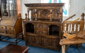 Edwardian Carved Oak Court Cupboard with a panelled top supported by four spindles,