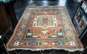"""Large Wool Rug measures 90"""" x 67"""" with cream fringing."""