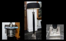 A Modern Contemporary Standard Lamp, black column with chrome fittings and large black shade.