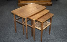 Nest of Three Interlocking Teak Tables, supported on round tapering legs,