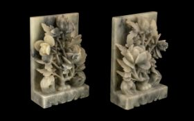 Pair of Chinese Grey Soapstone Bookends, carved as flowering roses on a ledge, c1930s,