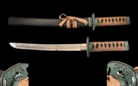 "A Japanese Short Sword - decorative model. Length 20.5"". Please see accompanying images."