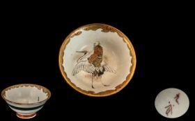 Small Satsuma Saki Cup decorated with a sage riding a crane; character marks to base; 2 inches (