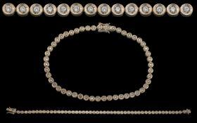 A Contemporary Designed 18ct White Gold - Attractive Diamond Set Line Bracelet.