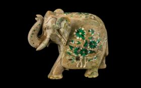 Inlaid Indian Soapstone Elephant with its trunk up, decorated to its back with a floral pattern,