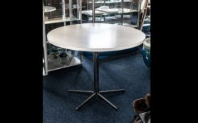 Contemporary Circular White Dining Table raised on chrome pedestal base with five star base.