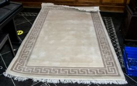 """Large Indian Rug in cream with beige border and tassels. Measures approx 61"""" wide x 96"""" long."""