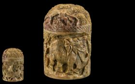 Oriental Carved Soapstone Lidded Jar, profusely carved with elephants, lions and deer to the body.