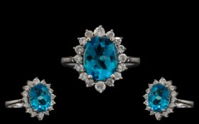 18ct White Gold - Attractive and Quality Blue Topaz and Diamond Set Cluster Ring.