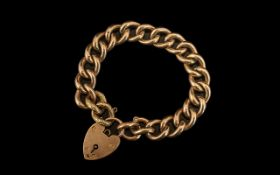 Antique Period 9ct Gold Curb Bracelet with attached large 9ct gold heart shaped padlock.