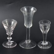 A wheel-engraved cordial glass and two wine glasses