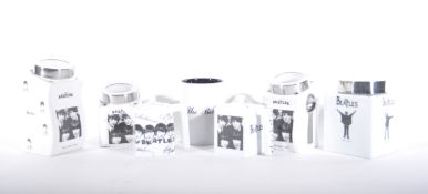 A collection of reproduction Beatles Ware in black and white, two teapots, storage jars etc.