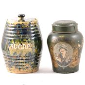 A Dark Shag stoneware shop tobacco jar with tin lid and a majolica glaze sugar jar.
