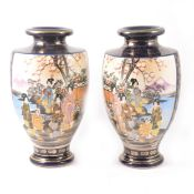 A pair of Japanese Satsuma shouldered vases decorated with two panels of colourful figures in a
