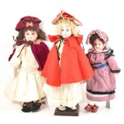 Three German bisque head dolls; Two Armand Marseille, and one other.