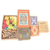 A box of vintage games; including puzzles, Dominoes, playing cards, Ludo, etc