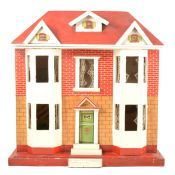 A 1940s wooden dolls house, Georgian style, with painted exterior