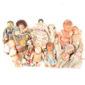 Victorian and later miniature dolls; twelve including bisque, wooden and celluloid examples.