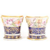 A pair of Staffordshire cache pots