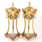 A pair of Louis XVI style bronzed and gilt metal cassolettes en athénienne,