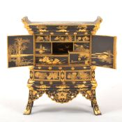 A Japanese black metal and gilt decorated 'kodansu' table cabinet