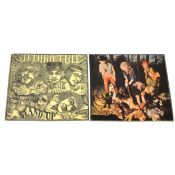 Two Jethro Tull vinyl records; This Was and Stand Up