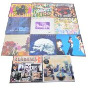 """Twelve LP and 12"""" single vinyl records; mostly 1990s music"""