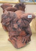 A pair of moulded terracotta griffins height 31cm