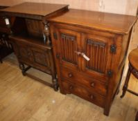A small reproduction oak court cupboard, W.76cm and a linenfold cupboard