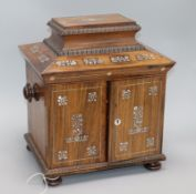 A Victorian mother of pearl inlaid rosewood jewellery cabinet