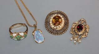 A 14k and gem set pendant, one other 14k pendant, a yellow metal and gem set brooch and a 14k ring.