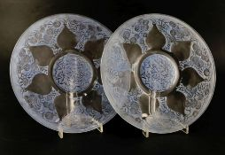 A pair of Lalique 'Vases' plates, reverse-moulded with blue-stained decoration, VDA and France