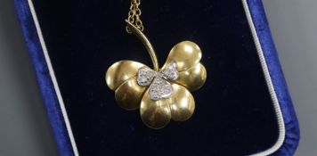 A modern 18ct gold and diamond set leaf pendant, on an 18ct gold chain, in Garrard & Co box, pendant