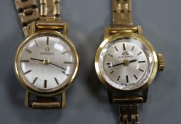 A ladys' Omega 9ct gold wristwatch and a similar Bucherer wristwatch, both with 9ct gold bracelets.