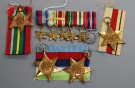 A WW2 medal group of six to Lieut. G.I.L. Greenlees RNVR and matching miniatures