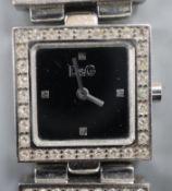 A lady's stainless steel and paste set Dolce & Gabbana quartz dress wrist watch.