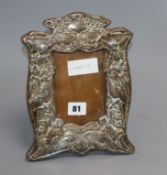 A Victorian embossed silver photograph frame (a.f.) height 25cm