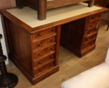 A 20th century mahogany pedestal desk, fitted ten small drawers, with side locking plates W.140cm