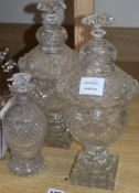 A pair of Regency style glass confitures and covers and a small Regency style decanter (3)