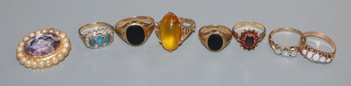 Seven assorted 9ct and gem set rings including five stone opal and a 9ct gem set brooch.