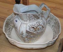 A gilt decorated jug and basin